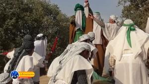 گزارش تصویری مراسم بازسازی عید غدیر خم در روستای تمنک از توابع بخش پاتاوه شهرستان دنا (۸۷)